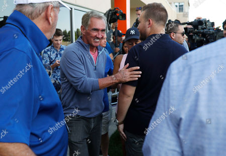 Mike shanahan, r m. Retired NFL head coach Mike Shanahan, center, talks to reporters during a combined NFL training camp at which the Denver Broncos hosted the San Francisco 49ers, at the Broncos' headquarters in Englewood, Colo