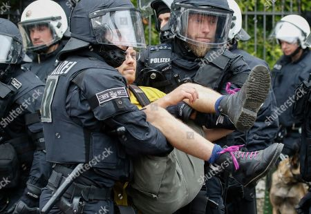 Police officers carry a demonstrator while resolving a roadblock during a protest against a neo-Nazi march commemorating Rudolf Hess, in Ingelheim, Germany, 17 August 2019. The demonstrators react to a neo-Nazi march to mark the death of Hitler's deputy Rudolf Hess was organized by the group 'Die Rechte' in Rheinland-Pfalz (The Right in Rhineland Palatinate) in Ingelheim.