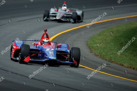 Will Power, Alexander Rossi. Alexander Rossi (27) leads Will Power (12) through Turn 3 during a practice session for Sunday's IndyCar Series auto race at Pocono Raceway, in Long Pond, Pa