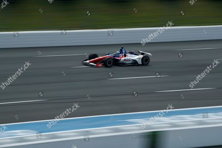 Tony Kanaan drives through Turn 3 during a practice session for Sunday's IndyCar Series auto race at Pocono Raceway, in Long Pond, Pa