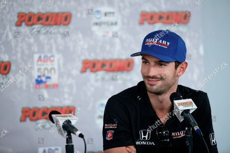 Alexander Rossi speaks during a news conference for Sunday's IndyCar Series auto race at Pocono Raceway, in Long Pond, Pa