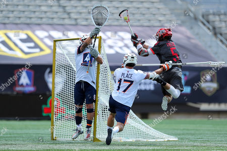 Chaos' Connor Fields (5) leaps to shoot as Archers' goalie Adam Ghitelman (8) reaches for the save while Archers' Jackson Place (17) defends during a Premier Lacrosse League game on in Hamilton, Ontario