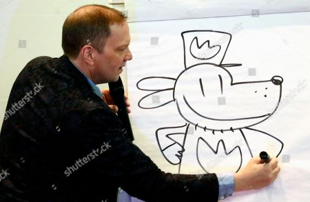 """Author and cartoonist Dav Pilkey shows how he draws Dog Man, at the Mississippi Book Festival in Jackson, Miss. Pilkey, the creator of the """"Captain Underpants"""" series, was one of several dozen authors who participated in a variety of panels or sitdown interviews for festival attendees"""