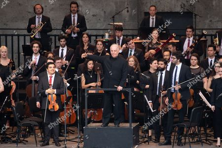 Conductor Daniel Barenboim (C) and the West-Eastern Divan Orchestra greet audience during its 20th anniversary concert at the Forest Stage (Waldbuehne) in Berlin, Germany, 17 August 2019. The orchestra is based in Seville, Spain, consisting of musicians from countries in the Middle East and Spanish background.