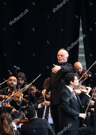 Stock Picture of Conductor Daniel Barenboim and the West-Eastern Divan Orchestra perform during its 20th anniversary concert at the Forest Stage (Waldbuehne) in Berlin, Germany, 17 August 2019. The orchestra is based in Seville, Spain, consisting of musicians from countries in the Middle East and Spanish background.