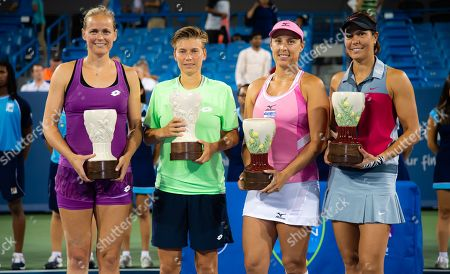 Anna Lena Groenefeld of Germany & Demi Schuurs of the Netherlands and Andreja Klepac of Slovenia & Lucie Hradecka of the Czech Republic pose with their trophies after the doubles final