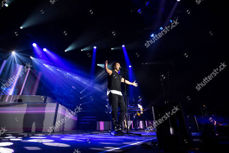 Puerto Rican singer, songwriter Luis Fonsi performs during his concert in Papp Laszlo Sports Arena in Budapest, Hungary, 17 August, 2019.