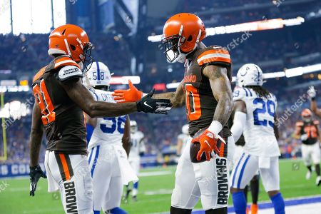 Stock Image of Cleveland Browns wide receiver Jaelen Strong, right, celebrates his touchdown catch with Rashard Higgins (81) during the first half of an NFL preseason football game against the Indianapolis Colts in Indianapolis