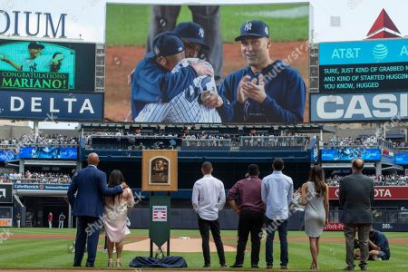 Mariano Rivera, Clara Rivera, Joe Torre. Former New York Yankees pitcher and National Baseball Hall of Fame inductee Mariano Rivera, left, joined by his wife Clara, members of his family and former New York Yankees manager Joe Torre, right, watch a video featuring Rivera, Derek Jeter, and Andy Pettitte during a ceremony in his honor before a baseball game between the New York Yankees and the Cleveland Indians, in New York