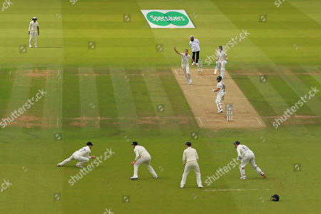 LONDON, ENGLAND. 17 AUGUST Rory Burns of England catches the ball to dismiss Matthew Wade of Australia off the bowling of Stuart Broad during the 2nd Specsavers Ashes Test Match, at Lords Cricket Ground, London, England