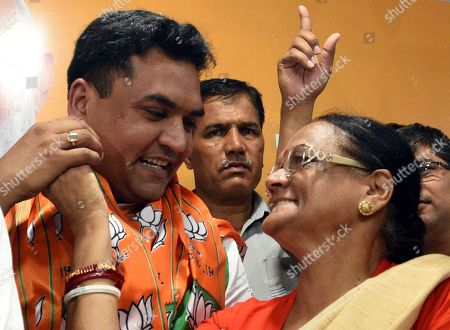 Stock Photo of Former east Delhi Mayor and mother of Former Delhi Cabinet Minister and AAP MLA Kapil Mishra Annapurna Mishra congratulates her son after he joined the Bharatiya Janata Party in the presence of National Vice President and in charge Delhi BJP Shyam Jaju, Delhi BJP President Manoj Tiwari, Vijay Goel, and leader of opposition Delhi Assembly Vijender Gupta among others, at Delhi BJP office