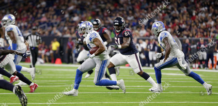 Detroit Lions defensive back Andrew Adams (24) returns an interception against the Houston Texans during the first half of an NFL preseason football game, in Houston