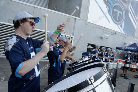 Adam Anderson, left, plays with a drum line outside Nissan Stadium before a preseason NFL football game between the Tennessee Titans and the New England Patriots, in Nashville, Tenn