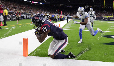 Houston Texans wide receiver Vyncint Smith (17) catches a pass for a touchdown as Detroit Lions defensive back Andrew Adams (24) defends during the first half of an NFL preseason football game, in Houston