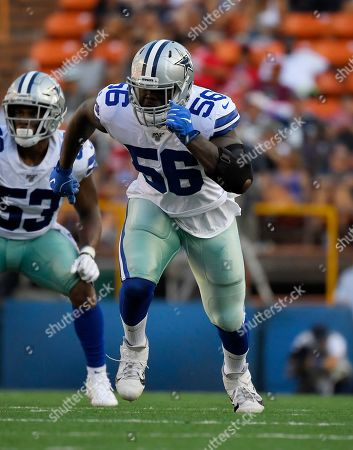 Dallas Cowboys defensive end Joe Jackson runs a play during the first half of a preseason NFL football game against the Los Angeles Rams, in Honolulu