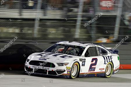 Brad Keselowski (2) goes down the back straight during a NASCAR Cup Series auto race, in Bristol, Tenn