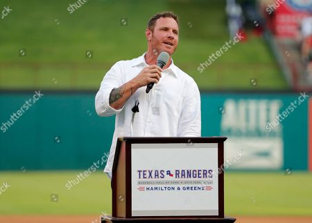 Former Texas Rangers player Josh Hamilton makes comments during a ceremony where the club inducted him into its Hall of Fame, before the team's baseball game against the Minnesota Twins in Arlington, Texas