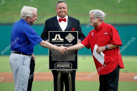 Stock Picture of Tom Schieffer, Richard Greene. Tom Schieffer, architect of Globe Life Park in Arlington, presents former city mayor Richard Greene, right, with a plaque during a team hall of fame induction ceremony before a baseball game against the Minnesota Twins in Arlington, Texas