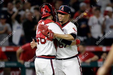 Taylor Cole, Anthony Bemboom. Los Angeles Angels' Hansel Robles, right, and catcher Anthony Bemboom celebrate the team's 6-5 win over the Chicago White Sox in a baseball game, in Anaheim, Calif