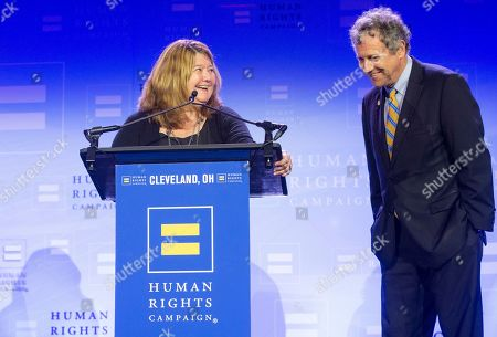 Pulitzer Prize winning journalist Connie Schultz and her husband, United States Senator Sherrod Brown laugh during her speech at the Human Rights Campaign Cleveland Dinner
