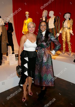 "Jennifer Rogien, Michelle R. Cole. Russian Doll"" costume designer Jennifer Rogien, left, and ""Black-ish"" costume designer Michelle R. Cole, are pictured with displays of their Emmy-nominated work during the premiere of the 13th Annual Art of Television Costume Design at FIDM Museum & Galleries on in Los Angeles"