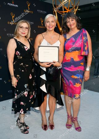 "Jennifer Rogien, Laura Guzik, Terry Ann Gordon. Television Academy Costume Design Governors Laura Guzik, left, and Terry Ann Gordon, right, present costume designer Jennifer Rogien with an Emmy nominee certificate for ""Russian Doll"" at the 13th Annual Art of Television Costume Design at FIDM Museum & Galleries on in Los Angeles"