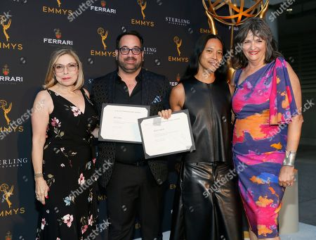 "Art Conn, Zaldy Goco, Laura Guzik, Terry Ann Gordon. Television Academy Costume Design Governors Laura Guzik, left, and Terry Ann Gordon, right, present Emmy nominee certificates to this year's nominated costume design team from ""RuPaul's Drag Race"" Art Conn, second from left, and Zaldy Goco, at the 13th Annual Art of Television Costume Design at FIDM Museum & Galleries on in Los Angeles"