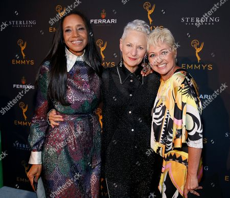 Michelle R. Cole, Lou Eyrich, Daniela Gschwendtner. Costume designers Michelle R. Cole, from left, Lou Eyrich and Daniela Gschwendtner, celebrate their Emmy nominations for outstanding costume design at the premiere of the 13th Annual Art of Television Costume Design at FIDM Museum & Galleries on in Los Angeles