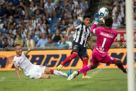 Jesus Gallardo (C) of Rayados de Monterrey in action against goalkeeper Alfredo Talavera (L) of Diablos Rojos de Toluca during the Apertura Tournament soccer match between Rayados de Monterrey and Diablos Rojos de Toluca, held at the BBVA Stadium in Monterrey Mexico, 17 August 2019.