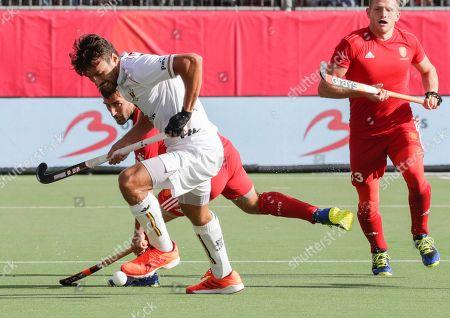 Simon Gougnard of Belgium and Adam Dixon (Bk) of England in action during the EuroHockey 2019 men match between Belgium and England in Antwerp, Belgium, 18 August 2019.