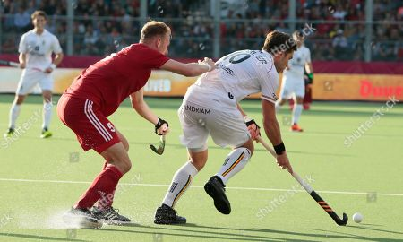 Belgium's Cedric Charlier, vies for the ball against England's David Ames during a men's European Championships field hockey match between England and Belgium at the Wilrijkse Plein, Antwerp, Belgium