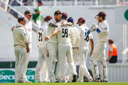 Jordan Clark of Surrey celebrates his first wicket Felix Organ of Hampshire bowled and caught by Ben Foakes of Surrey during the Specsavers County Champ Div 1 match between Surrey County Cricket Club and Hampshire County Cricket Club at the Kia Oval, Kennington