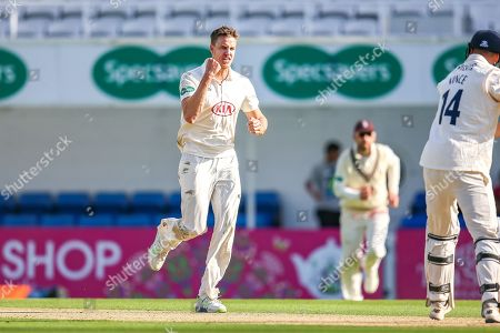 Wicket Morne Morkel of Surrey celebrates bowling James Vince of Hampshire caught Ben Foakes of Surrey during the Specsavers County Champ Div 1 match between Surrey County Cricket Club and Hampshire County Cricket Club at the Kia Oval, Kennington
