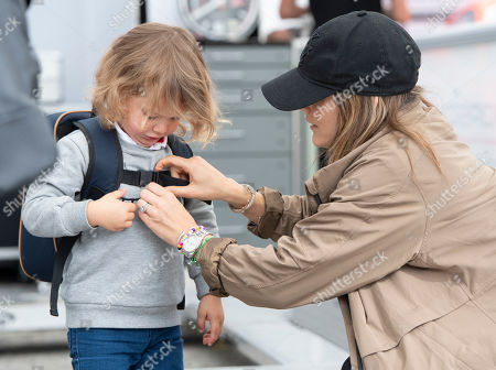 Princess Sofia (R) of Sweden helps her son Prince Alexander (L) with his backpack as they visit the Gellerasen Motor stadium in Karlskoga, Sweden, 18 August 2019. They were accompanying Prince Carl Philip of Sweden (not in picture) who has been competing as a racing driver in various touring car championships and endurance races in Scandinavia.