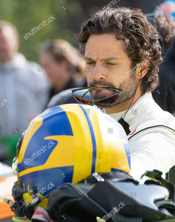 Prince Carl Philip (R) of Sweden gets ready to compete in one of the VIP cars during the Scandinavian Porsche Carrera Cup at the Gellerasen Motor stadium in Karlskoga, Sweden, 18 August 2019. Prince Carl Philip of Sweden, the only son of Swedish King Carl Gustav and Queen Silvia, has already been competing as a racing driver in various touring car championships and endurance races in Scandinavia in the past.