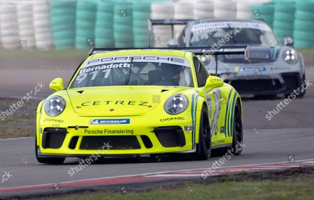Stock Image of Prince Carl Philip of Sweden in a yellow Porsche marked with the number #911 and the name Bernadotte competes in the Scandinavian Porsche Carrera Cup at the Gellerasen Motor stadium in Karlskoga, Sweden, 18 August 2019. Prince Carl Philip of Sweden, the only son of Swedish King Carl Gustav and Queen Silvia, has already been competing as a racing driver in various touring car championships and endurance races in Scandinavia in the past.