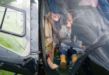 Stock Image of Princess Sofia (L) and her son Prince Alexander (R) check the interior of a helicopter as they visit the Gellerasen Motor arena in Karlskoga, Sweden, 18 August 2019. They were accompanying Prince Carl Philip of Sweden (not in picture) who was driving one of the VIP cars during the Scandinavian Porsche Carrera Cup the same day. The only son of Swedish King Carl Gustav and Queen Silvia has already been competing as a racing driver in various touring car championships and endurance races in Scandinavia in the past.