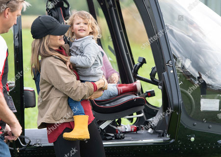 Stock Image of Princess Sofia (2-L) and her son Prince Alexander (C) check a helicopter as they visit the Gellerasen Motor arena in Karlskoga, Sweden, 18 August 2019. They were accompanying Prince Carl Philip of Sweden (not in picture) who was driving one of the VIP cars during the Scandinavian Porsche Carrera Cup the same day. The only son of Swedish King Carl Gustav and Queen Silvia has already been competing as a racing driver in various touring car championships and endurance races in Scandinavia in the past.