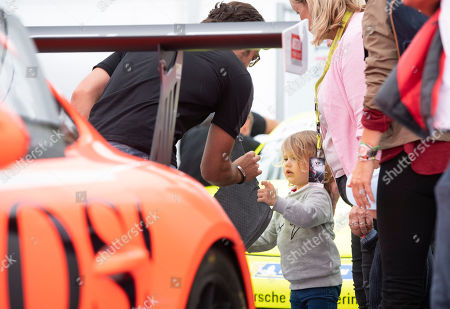 Stock Picture of Prince Carl Philip (L) of Sweden shows a piece of wreckage to his son Prince Alexander (C) after the door of the VIP car he was driving was damaged during the Scandinavian Porsche Carrera Cup at the Gellerasen Motor stadium in Karlskoga, Sweden, 18 August 2019. Prince Carl Philip of Sweden, the only son of Swedish King Carl Gustav and Queen Silvia, has already been competing as a racing driver in various touring car championships and endurance races in Scandinavia in the past.