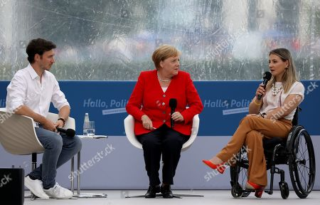 (L-R) Fromer Ski racer Christian Neureuther, German Chancellor Angela Merkel and former race track cyclist Kristina Vogel talk on stage during the 21st open day of the German Federal Government in the chancellery in Berlin, Germany, 18  August 2019. During the open day of the Federal Government, visitors may have a look inside the Chancellery and most of the Government's ministries on 17 and 18 August 2019.