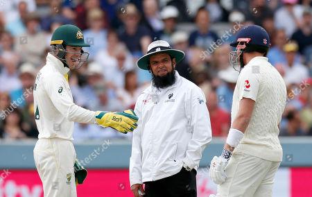 Tim Paine the Australia wicketkeeper/captain jokes with Jonny Bairstow of England and Umpire Aleem Dar