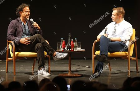 Alejandro Gonzalez Inarritu (L) speaks during a masterclass lecture within the 25th Sarajevo Film Festival at the National Theater in Sarajevo, Bosnia and Herzegovina, 18 August 2019. Gonzalez Inarritu during the festival was honored with the 2019 Honorary Heart of Sarajevo Award on 16 August. The 25th Sarajevo Film Festival runs from 16 to 23 August 2019 and will present about 270 films. On right is moderator Mike Goodridge, the Artistic Director of the International Film Festival & Awards Macao (IFFAM).