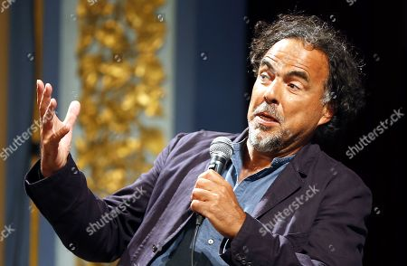 Alejandro Gonzalez Inarritu speaks during a masterclass lecture within the 25th Sarajevo Film Festival at the National Theater in Sarajevo, Bosnia and Herzegovina, 18 August 2019. Gonzalez Inarritu during the festival was honored with the 2019 Honorary Heart of Sarajevo Award on 16 August. The 25th Sarajevo Film Festival runs from 16 to 23 August 2019 and will present about 270 films. On right is moderator Mike Goodridge, the Artistic Director of the International Film Festival & Awards Macao (IFFAM).