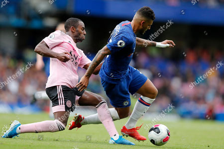 Leicester's Ricardo Pereira fights for the ball with Chelsea's Michy Batshuayi, right, during the English Premier League soccer match between Chelsea and Leicester City at Stamford Bridge stadium in London