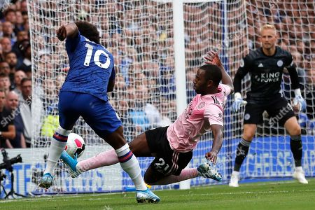 Stock Picture of Leicester's Ricardo Pereira tries to block a shot from Chelsea's Willian, left, during the English Premier League soccer match between Chelsea and Leicester City at Stamford Bridge stadium in London