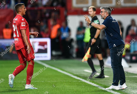 Union's head coach Urs Fischer (L)  talks to Union's Grischa Promel during the German Bundesliga soccer match between FC Union Berlin and RB Leipzig in Berlin, Germany, 18 August 2019.