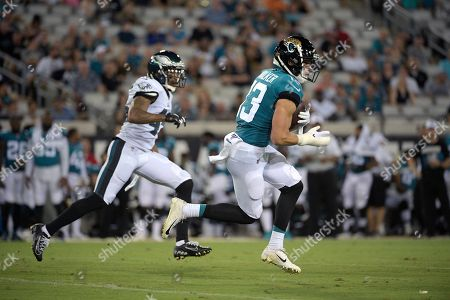 Jacksonville Jaguars wide receiver Michael Walker (13) runs after catching a pass in front of Philadelphia Eagles defensive back Orlando Scandrick (45) during the first half of an NFL preseason football game, in Jacksonville, Fla