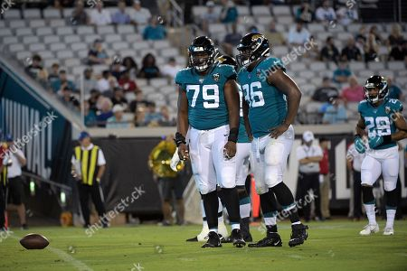 Jacksonville Jaguars defensive tackle Andrew Williams (79) and defensive end Datone Jones (96) set up for a play during the second half of an NFL preseason football game against the Philadelphia Eagles, in Jacksonville, Fla