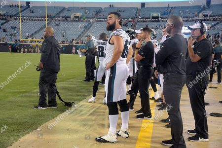 Philadelphia Eagles center Jason Kelce (62) watches from the sideline during the second half of an NFL preseason football game against the Jacksonville Jaguars, in Jacksonville, Fla