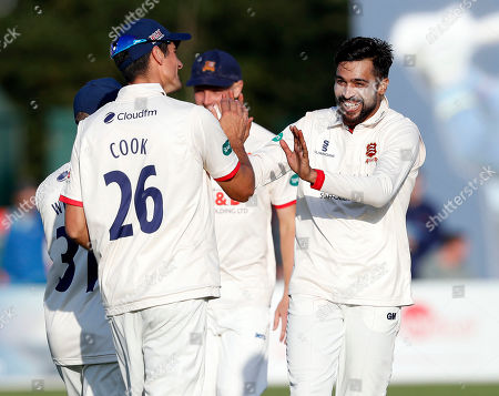 Stock Image of Mohammad Amir of Essex (facing) is congratulated by Alistair Cook after bowling Ollie Robinson during Kent CCC vs Essex CCC, Specsavers County Championship Division 1 Cricket at The Spitfire Ground on 18th August 2019